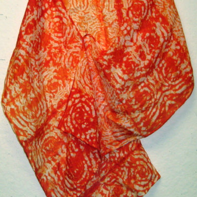 Orange Silk Shibori Scarf With Spiral Pattern by Maureen Jakubson